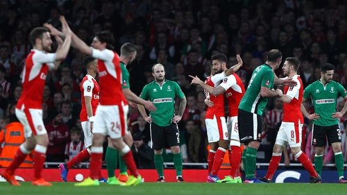 Arsenal players celebrate Theo Walcott's opener at the Emirates