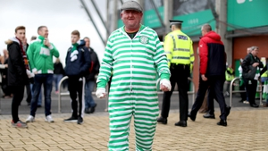 A Celtic fan gets ready for a comfortable win