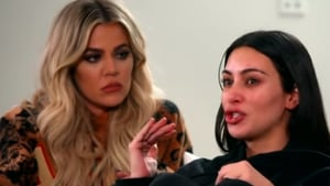 """Kardashian with sister Khloé in the Keeping Up with the Kardashians trailer - """"They had the gun up to me and I knew they were just going to shoot me in the head"""" Screengrab: E!"""