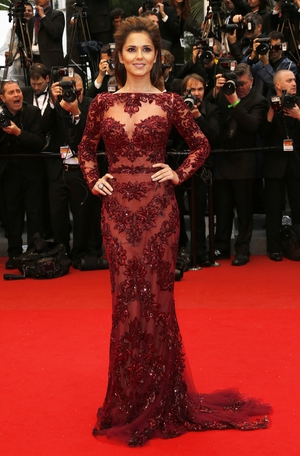 Attending the 2013 Cannes Festival, Cheryl is magnificent in this burgundy embellished Zuhair Murad gown.