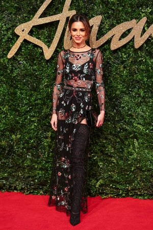 This sheer embroidered dress and thigh boots combo from Topshop is perfect on the mesmerizing singer at the British Fashion Awards in 2015.