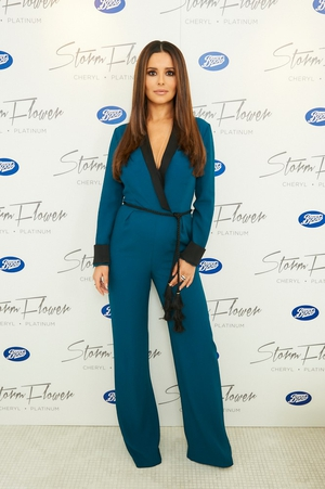 The singer keeping it casual but chic in this plunging jumpsuit at the signing session for her fragrance 'StormFlower' in 2016.