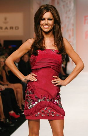 Cheryl Cole is a lady in red as she walks the runway of the Fashion For Relief show at London Fashion Week in 2009.