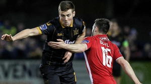 Dundalk's Patrick McEleney (L) tussles with Derry City's Nathan Boyle