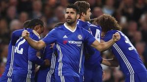 Diego Costa celebrates as Chelsea mob goalscorer N'Golo Kante