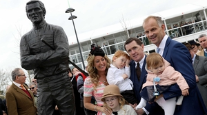 AP McCoy alongside his wife Chanelle and children beside his new statue