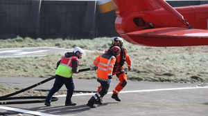 An Irish Coast Guard helicopter returns to Blacksod for refuelling, as the search continues