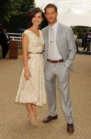 Tom Hardy and wife Charlotte Riley at the Goodwood Racecourse in 2010. The actor hits British style peak in this checked suit, brown shoes and belt!