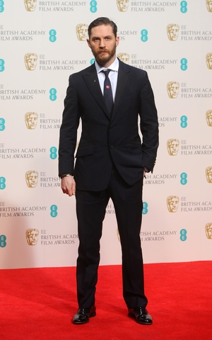 The actor looks very classy in a navy suit and shiny shoes at the British Academy Film Awards in 2014.