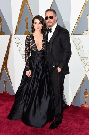 The absolutely stunning couple at the Oscars ceremony in 2016.  Tom is wearing a flawless Gucci suit, bow tie and sunglasses.