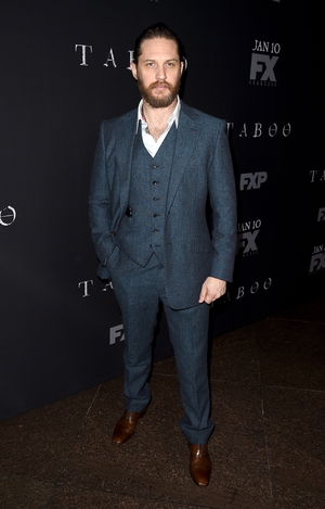 All in grey at the premiere of FX's 'Taboo' series this year. We love how Tom rocks a discreet necklace under his shirt! He definitely an up-and-coming style icon!