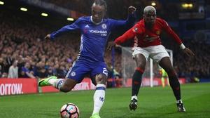 Paul Pogba (R) closes down Chelsea's Willian
