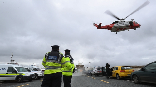 A Coast Guard helicopter arrives in Blacksod to refuel as the search continues