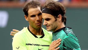 Rafa Nadal (L) and Roger Federer clash in the French Open semi-final on Friday