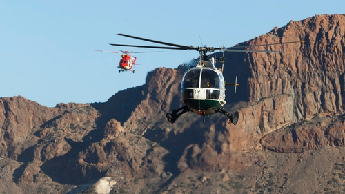 Four helicopters evacuated the tourists, many wearing shorts and sandals, from shelters near the summit of the volcano