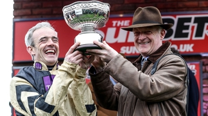 Ruby Walsh and Willie Mullins (R) celebrate with the Sun Bets Stayers' Hurdle trophy