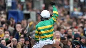 Jockey Richard Johnson celebrates after his winning ride on Defi Du Seuil
