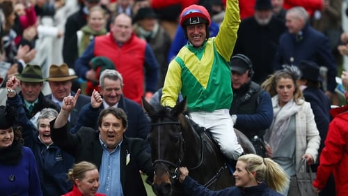 Robbie Power celebrates his victory aboard Sizing John