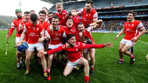 Cuala players celebrate at the final whistle