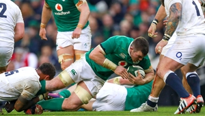 Peter O'Mahony is tackled by Courtney Lawes