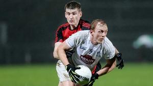 Kildare's Keith Cribbin and Down's Conor Maginn battle for possession