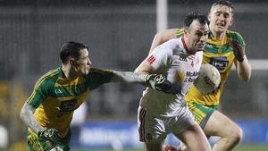 Tyrone's Cathal McCarron evades Martin O'Reilly and Hugh McFadden