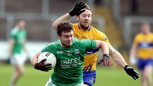 Fermanagh's Eoin McManus holds off Clare's John Hayes