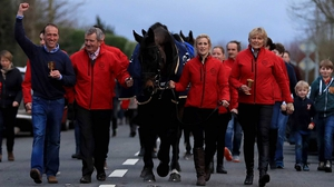 Sizing John Sizing John is led into Moone Village with jockey Robbie Power, head lad Eamonn Leigh, groom Ashley Hussey and trainer Jessica Harrington
