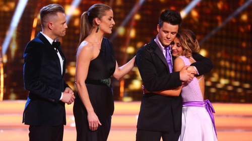 An emotional Dayl is comforted on DWTS