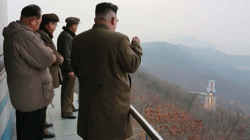 A North Korean media handout shows leader Kim Jong-un watching the rocket test