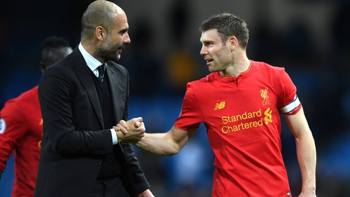 Pep Guardiola shakes hands with Liverpool captain James Milner after the game