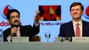 Chairman of India's Aditya Birla Group Kumar Mangalam Birla and Vodafone Group CEO Vittorio Colao at today's announcement
