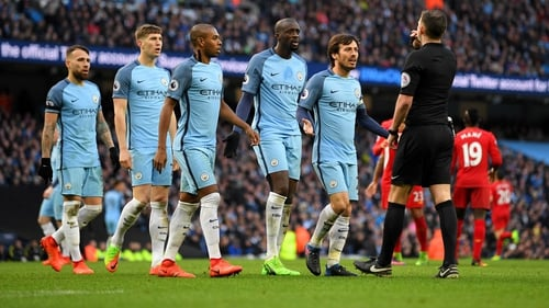 Manchester City players hone in on Michael Oliver