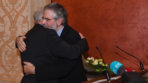 Martin McGuinness is embraced by Gerry Adams at a press conference in Belfast in January