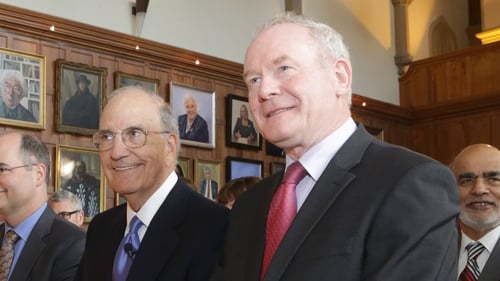 Former US Special Envoy for Northern Ireland George Mitchell (L) with Martin McGuinness on a visit to Belfast in 2015