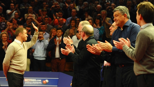 Stephen Hendry (L) waves goodbye to the Crucible crowd in 2012