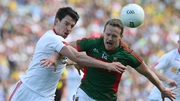 Tyrone's Mattie Donnelly and Andy Moran of Mayo in the 2016 All-Ireland quarter-final