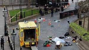 A body is covered by a sheet outside the Palace of Westminster