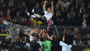 Lukas Podolski marked his international swan-song with a cracking goal