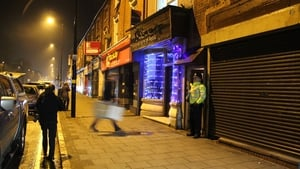 A police officer stands outside a premises in Birmingham were a raid was conducted