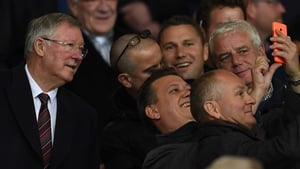 Alex Ferguson poses for a selfie during a Europa League tie at Old Trafford