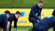 James McCarthy shares a joke with Ireland captain Seamus Coleman at squad training on Thursday