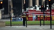 Police forensic officers work in Parliament Square following yesterday's attack