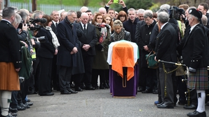 The coffin of Martin McGuinness outside his house ahead of his funeral mass