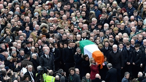Martin McGuinness's coffin is carried to the church in Derry