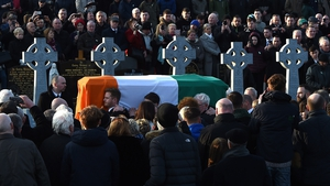 Martin McGuinness's coffin arrives at Derry City Cemetery