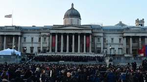 Crowds attending a vigil in London