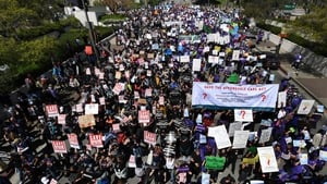 Protesters march towards the Federal Building during a 'Save the Affordable Care Act' rally in Los Angeles yesterday