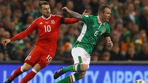 Ramsey tackles Ireland's Glenn Whelan