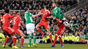 Richard Keogh challenges Gareth Bale